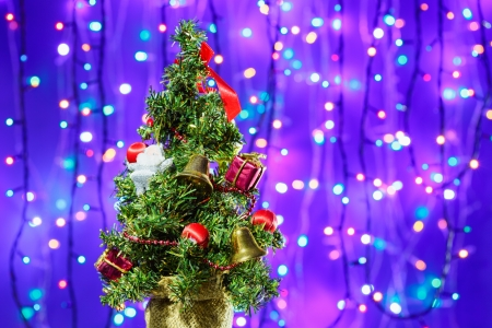 Decorated Christmas tree on multicolor bokeh background Stock Photo - 16229541
