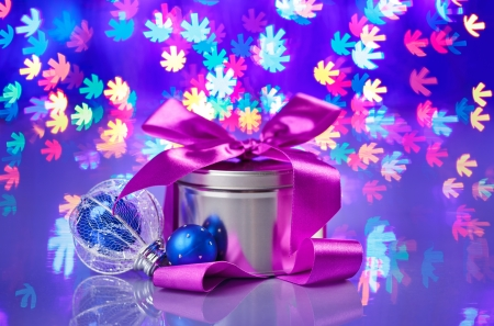 New Year composition with fancy box on snowflake shaped bokeh background photo