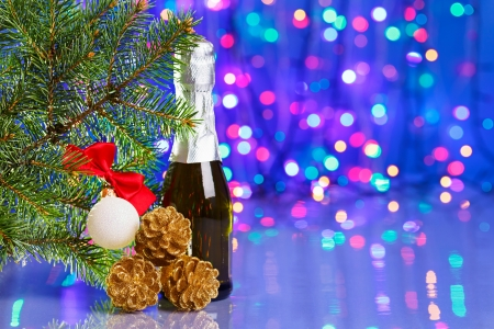 Christmas tree decorations with spruce and champagne on bokeh background photo