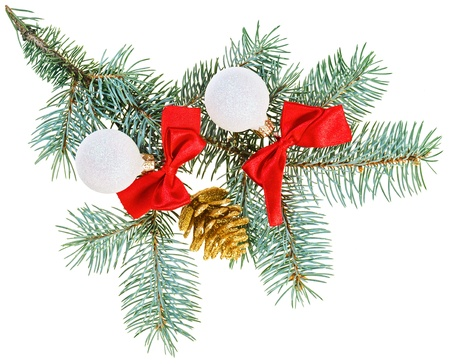 Christmas balls, red bows and cone on fir branch, isolated on white photo