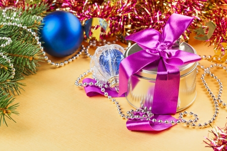 New Year present and decorations on yellow background photo