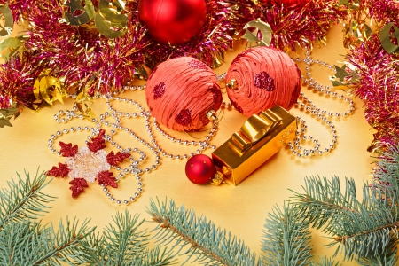 Christmas balls and decorations on golden background photo