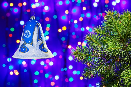 Christmas  decorations bell on multicolor circles bokeh background photo
