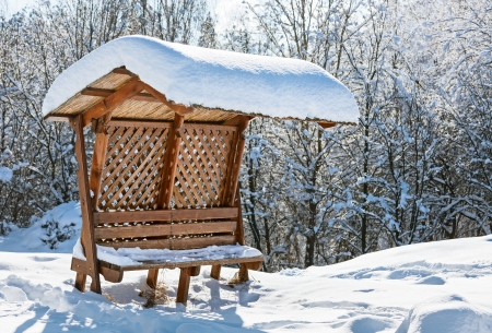roof light: Wooden awning bench covered by hard snow Stock Photo