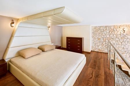 Modern minimalism style bedroom interior in beige tones photo