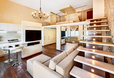 Modern minimalism style two-high drawing-room interior with staircase in beige tones photo