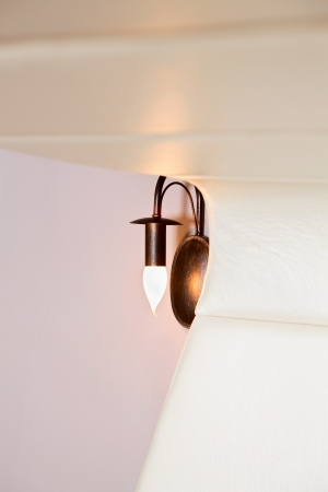 lather: Unusual lather headboard and lamp, interior detail