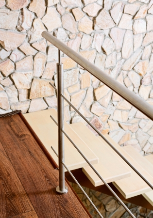 banister: Modern style staircase ashlar wall and, interior detail Stock Photo