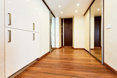 Modern minimalism style corridor interior with sliding-door mirror wardrobe Stock Photo