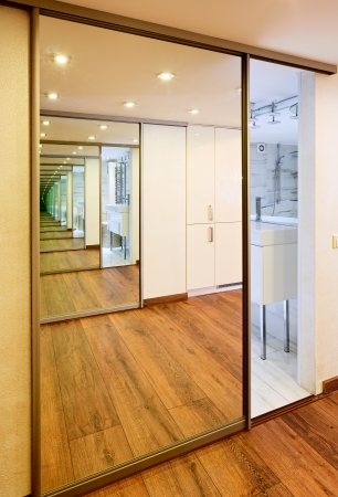 closet door: Sliding-door mirror wardrobe in modern hall interior with infinityreflections