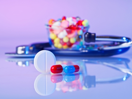 bolus: Pills and tablets macro still life on violet, medical therapeutic concept