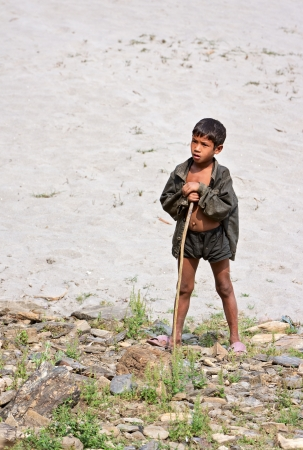 KALANKI - APRIL 2: Portrait of Nepalese herder boy with a rod April 2, 2009 in Kalanki Village, Kathmandu, Central Region, Nepal. In the first quarter of 2009-10, according to the Nepal Rastra Bank, the country exports had declined (17 percent) and import Stock Photo - 21596914