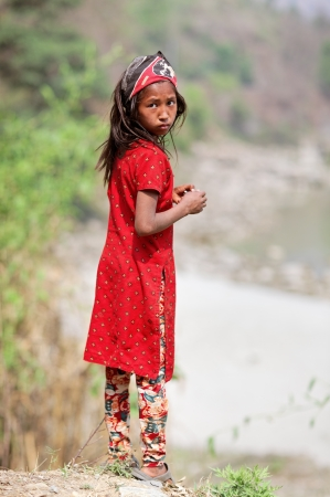 KALANKI - APRIL 2: Portrait of Nepalese girl in red dress April 2, 2009 in Kalanki Village, Kathmandu, Central Region, Nepal. In the first quarter of 2009-10, according to the Nepal Rastra Bank, the country exports had declined (17 percent) and imports co