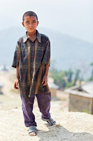indigence: NAGARKOT, NEPAL - APRIL 5  Portrait of little unidentified Nepalese boy on April 5, 2009 in Nagarkot Village, Kathmandu, Central Region, Nepal
