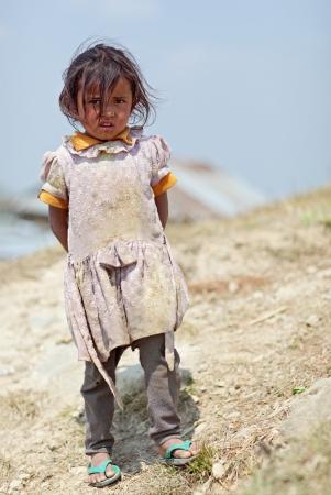 penury: NAGARKOT, NEPAL - APRIL 5  Portrait of little unidentified Nepalese girl on April 5, 2009 in Nagarkot Village, Kathmandu, Central Region, Nepal
