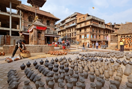 heritage site: BHAKTAPUR, NEPAL - APRIL 5  Bhaktapur pottery market square on April 5, 2009 in Bhaktapur, Nepal  Bhaktapur is listed as a World Heritage Site by UNESCO for its rich culture, temples, and wood, metal and stone artwork