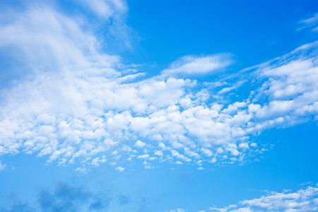 fleecy: Blue sky with fleecy clouds background