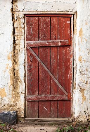red door: Old wooden plank vintage door Stock Photo