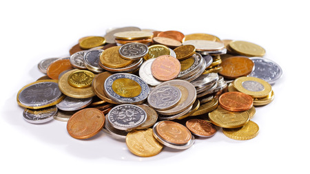 infinitely: Many old different coins heap over white background