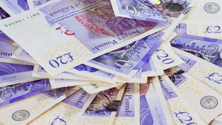 quid: Pound sterling bank notes business background