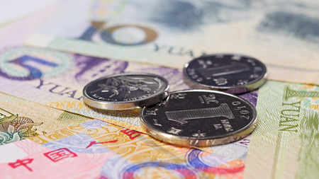 Yuan bank notes and coins business background, shallow depth of field Stock Photo