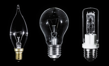 glower: Collage of 3 Edison lamps over black background, macro view Stock Photo