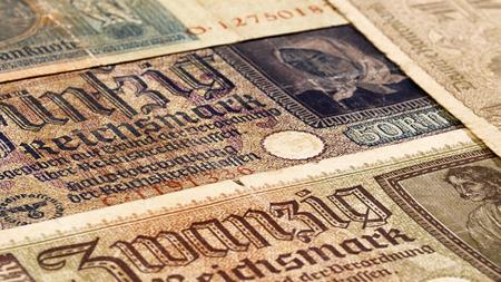 Reich: Third reich nazi banknotes 1942 WW2 in occupied Ukraine, vintage background