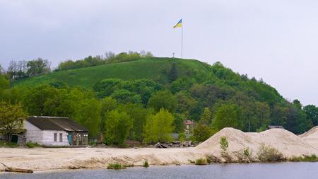 fluttering: Ukrainian flag fluttering over Devich Mountain in Trypillia village, Ukraine