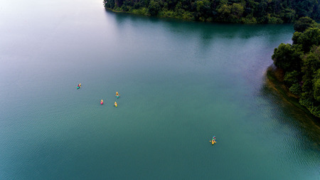 Kayaks on a gorgeous blue lake surrounded by greenery