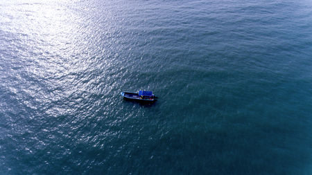 A Small boat in the Vast Sea Stock fotó