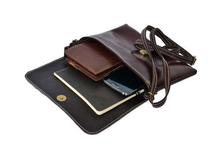 billfold: Old leather bag with scratches and stains - opened showing pens and cell phone