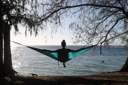 silhouette of a girl in hammock