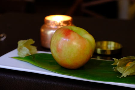 apple with candle on a dish 写真素材