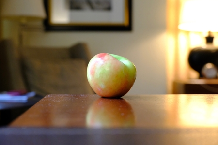 apple on the corner of a table