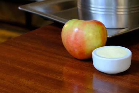 Apple with butter ramekin