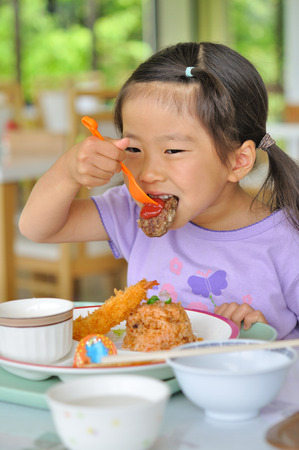 children eating: Girl eat dinner menu for children