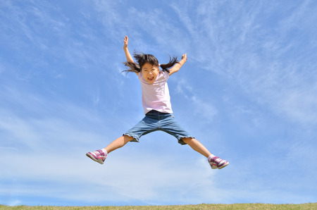 Girls jumping in the sky Stock Photo