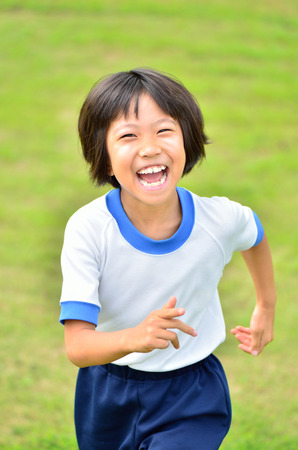 gym clothes: Girl running in the grass gym clothes Stock Photo