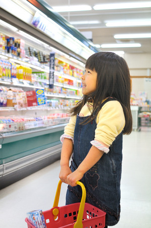 Girls shopping at the supermarket Stock Photo
