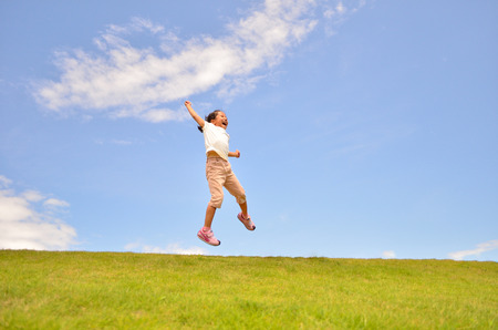 Girls jumping in the lawn