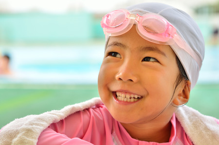 poolside: Girl laughs at poolside Stock Photo