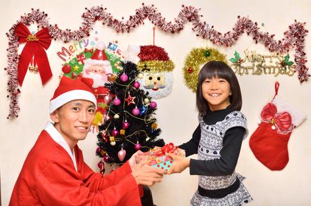 fancy dress party: Parents and children enjoy Christmas Stock Photo