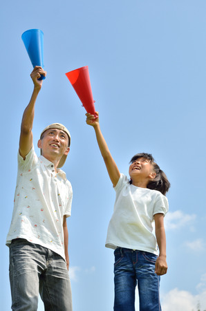 laughing out loud: The parent and child to cheer on the blue sky summer, megaphone