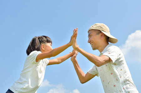 upper school: Parent-child in blue sky Stock Photo