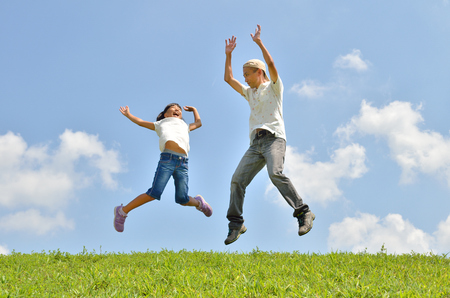 Parent-child jump in the blue sky