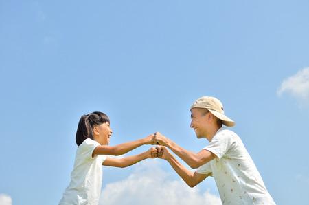 Parent-child in blue sky 스톡 콘텐츠