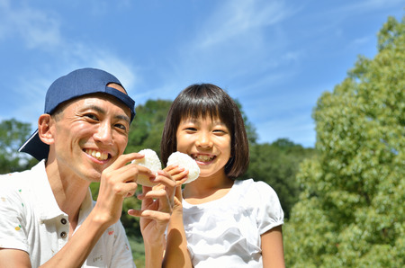 Parents and children eat rice ball