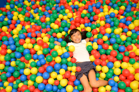 color balls: A girl playing with balls