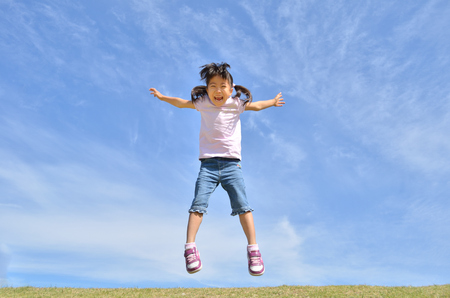 girls jumping in the sky