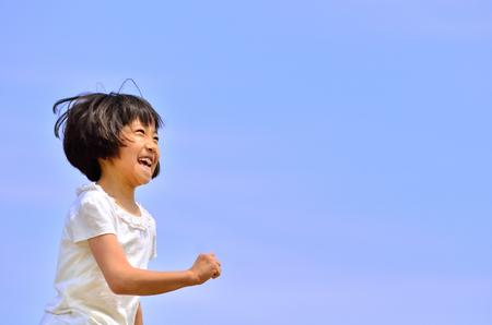 Girl running (blue sky)